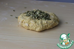 When the dough begins to form, add the pumpkin seeds and begin to knead the dough