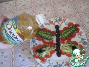 Decorate the butterfly cucumbers, black olives, salt, pour vegetable oil.