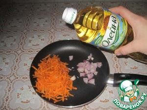 Onions and carrots are cut and fried in vegetable oil, add chicken cubes.