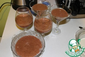 Pour chocolate mixture into glasses or other containers so that there is a place for white mixture.