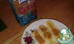A banana cut lengthwise, sprinkle with brown sugar