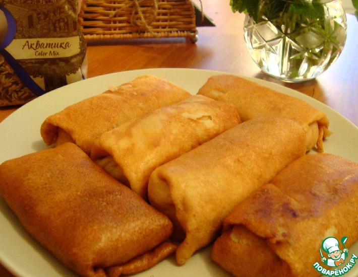 Рецепт: Фаршированные блины с капустой и рисом