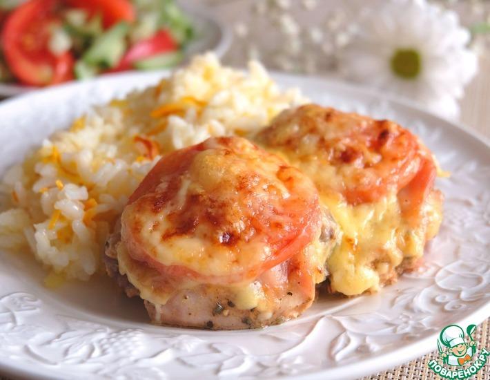 Рецепт: Куриные бедра под сырной шапкой