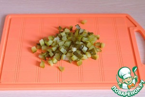 Pickled cucumbers cut into small cubes.