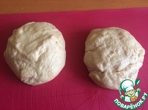 The risen dough press down, divide into two parts.