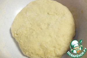 Gradually add the flour knead the dough.  The dough is kneaded until then, until it will not cease to stick to hands. The dough cover with a clean towel and put in a warm place for an hour to rise.