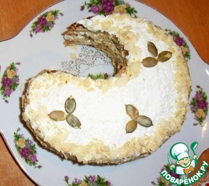 For decoration use almond crumb and pumpkin seeds. Cake put in the fridge for 2 hours.