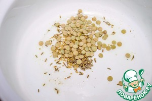 In a saucepan pour oil, put mustard seeds, cumin and lentils. Fry for 2 minutes.