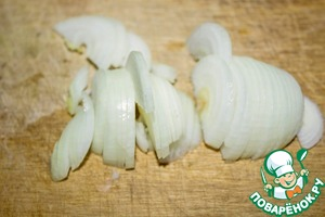 Onion peel and cut into half rings.