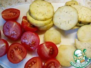 Eggplant cut into slices, and cherry tomatoes into halves.