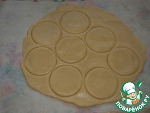 Roll out soft dough on the parchment. To cut circles.