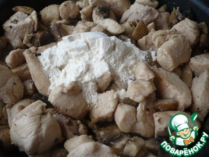 Then add to chicken and mushrooms tablespoon flour and all mix well. After that, continue to cook for about 2-3 minutes.