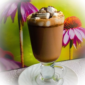 Into a glass pour hot chocolate, sprinkle marshmallows. Decorate with milk chocolate.  Bon appetit!