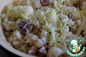 Mix the cabbage, zucchini and sauteed with onions sausage.  Add salt and spices to the vegetables to taste.