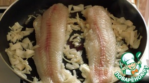 2. To fried onion add Pollock fillets and cook it on slow fire for 10 minutes.