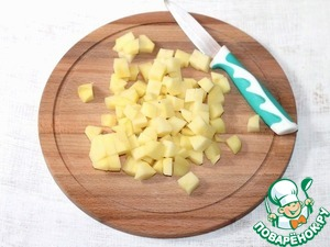 2. Potatoes cut into cubes and add boiling water to the barley.  Cook on low heat until tender.