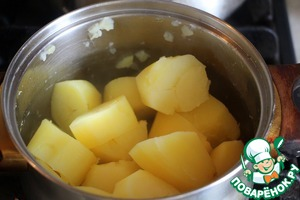 Boil potatoes until tender.