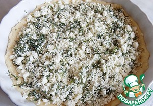 Spread out on the surface of the dough cheese with herbs.