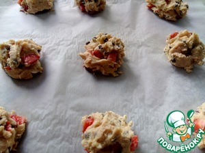 With a spoon of ice cream to put the dough balls on a parchment covered baking sheet.