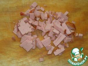 Sausage cut into cubes.