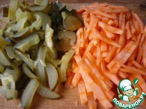 Carrots cut into sticks, salted cucumber cut into arbitrarily.