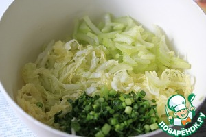 Shred cabbage, season with salt and sugar and gently muddle.  Celery cut into small pieces, add to the cabbage.  Add chopped green onions and parsley.