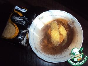 В отдельной посуде смешать 6 ст. л. просеянной муки, какао и разрыхлитель. Добавить сахар (3 - 4 ст. л., ориентируйтесь на свой вкус).    Я использовал тростниковый сахар Демерара от Мистраль.   Полученную смесь соединить с яичной и замесить тесто.