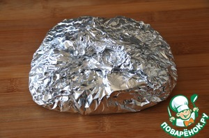 Carefully wrap it, so when baking not to spill the juice. Put in heated to 220 degree oven and cook 20 minutes.