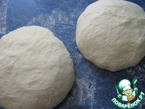 The dough is divided into two unequal parts.
