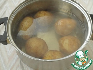 Potatoes wash thoroughly, cover with water and cook until tender.