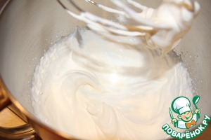 Whip the chilled cream until soft peaks form.