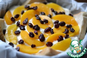 The last layer of peaches.  Sprinkle with cranberries.