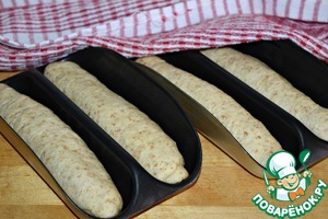 """The formed baguettes to put in a special form. These are the molds I have from HP. Cover with a linen towel and leave in for 7-10, let """"rest"""". At this time, turn the oven to warm, set the temperature to 180*."""