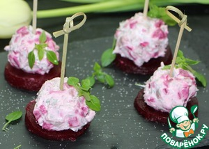 On each circle put 1 tbsp filling, forming a ball. For convenience to stick the skewers. Decorate with any greens.
