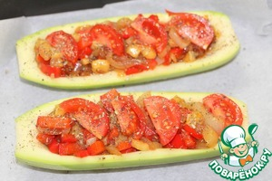 Baking tray lay a parchment, put the zucchini boats, slightly prisolit them from the inside, put the stuffing. From top to distribute quarter-cut cherry tomatoes. Bake in preheated to 180 degrees oven for 20-30 minutes, or until tender zucchini.