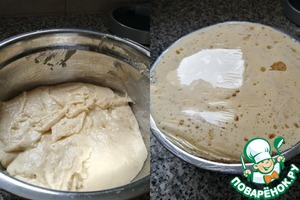 Put the dough in a bowl, cover with cling film and put in a warm place for 1 hour, the dough will increase by about 2-3 times.  I always make a few punctures with a fork in a food film.