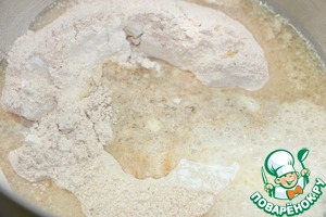 In a Cup mix olive oil and hot water. Pour liquid into dry ingredients and knead the dough with your hands.