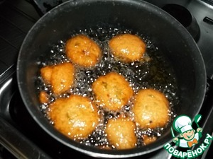 "In a saucepan heat enough for deep frying the amount of oil (so that the doughnuts floating in it). I check the readiness of oil by throwing a piece of raw potato. If potato is ""bubbled"", then the oil is hot enough. The batter to drop in the fryer with the help of two tablespoons. One spoon to scoop the dough (incomplete spoon, not to do big donuts) and the other to quickly move the batter in the deep fryer. Fry on the fire a little smaller than average until Golden brown on all sides, turning gently with a fork. Donuts are fried quickly for about 2 minutes on each side. Before each new batch, the dough mix."