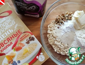 In a bowl, mix chopped walnuts, rolled oats, flour, baking powder, sugar and butter (from the fridge)