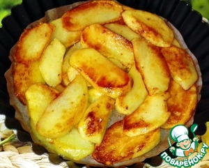 In the form put the parchment  and he laid out the potatoes.