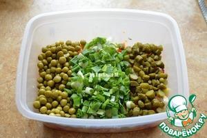Add the peas, chopped onion, and sliced cornichons;  Stir;