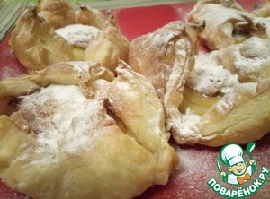 Get loecki from the oven, let cool slightly, sprinkle with powdered sugar.  In the baking process envelopes can be deployed, but it will not affect their taste, but on the contrary will give more crunch and oomph!