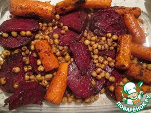 Mix the chickpeas with the remaining dressing and add to vegetables in the oven for 15 minutes until cooked
