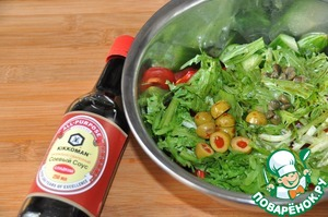 Sprinkle the salad with olive oil and sweet soy sauce. I have Kikkoman.