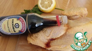 """Both pieces of chicken well to pour soy sauce from TM """"Kikkoman""""."""