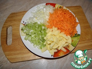Onions and celery cut into small cubes, potato cubes, carrots grate on a grater