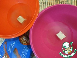 Warm water pour into two bowls. Dissolve yeast in each with sugar.