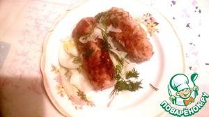 Обваляем мясные трубочки в сухарях, жарим на электробарбекю, смазав предварительно пластины смальцем. Можно жарить во фритюре или на гриле. Приятного аппетита!