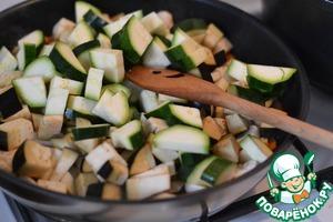 Add sliced eggplant and zucchini.  Mix well.