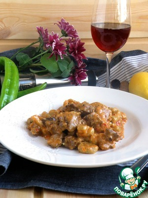 The dish is well served with lemon, spicy fresh pepper, and fresh herbs. A glass of red wine as well.